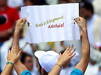 """Fedeli al raduno del Rinnovamento nello Spirito allo Stadio Olimpico di Roma, 1 giugno 2014.<br /> A believer holds a sign reading """"Jesus is the Lord! Alleluia!"""" during the Charismatic Movement gathering at Rome's Olympic stadium, 1 June 2014.<br /> UPDATE IMAGES PRESS/Isabella Bonotto<br /> <br /> STRICTLY ONLY FOR EDITORIAL USE"""