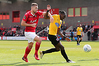 Nathan Smith of Dagenham and Redbridge and Michael Cheek of Ebbsfleet during Ebbsfleet United vs Dagenham & Redbridge, Vanarama National League Football at The Kuflink Stadium on 13th April 2019