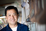 Kazuhito Komatsu, president of Komatsu Cutting Factory, poses for a photo at his company in Kofu City, Yamanashi Prefecture, Japan on 16 Oct. 2012.  Komatsu's father developed a world-first technique for cutting peals. Photographer: Robert Gilhooly