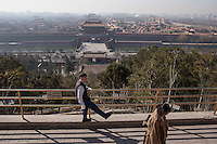 Visitors at the Pagoda of Jingshan Park overlooking the Fobidden City, Beijing.