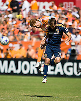 Houston Dynamo defender Andrew Hainault (31) and Los Angeles Galaxy forward Mike Magee (18) go up for the header.  Houston Dynamo tied Los Angeles Galaxy 0-0 at Robertson Stadium in Houston, TX on October 18, 2009.