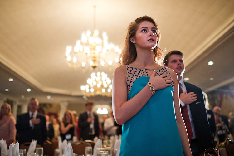 UNITED STATES - JUNE 18: Nicole Reed of Atlanta recites the Pledge of Allegiance during the Faith & Freedom Coalition's Road to Majority conference which featured speeches by conservative politicians at the Omni Shoreham Hotel, June 18, 2015. (Photo By Tom Williams/CQ Roll Call)