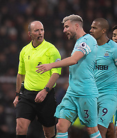 Referee Mike Dean (left) talking to Newcastle United's captain Paul Dummett <br /> <br /> Photographer David Horton/CameraSport<br /> <br /> The Premier League - Bournemouth v Newcastle United - Saturday 16th March 2019 - Vitality Stadium - Bournemouth<br /> <br /> World Copyright © 2019 CameraSport. All rights reserved. 43 Linden Ave. Countesthorpe. Leicester. England. LE8 5PG - Tel: +44 (0) 116 277 4147 - admin@camerasport.com - www.camerasport.com