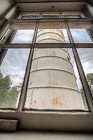Cana Island lighthouse in Baileys Harbor Wisconsin.  The station was established in 1870, and it is still operational with the original Third Order Fresnel lens. The 81 foot tower is constructed of steel, which was wrapped around the original brick in 1902. The attached keeper's house is of the same cream-colored Milwaukee brick that is used in other Door County lights. The cast iron lantern at the top of the tower has two levels--a watch room at the top of the tower with the lantern room above containing the lighthouse's lens.