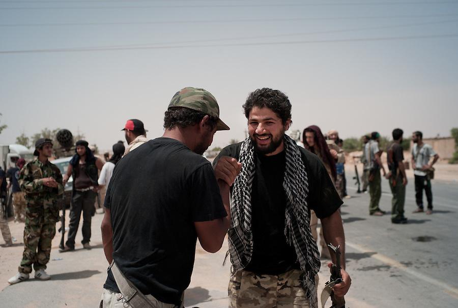 Rebel fighters celebrate victory in Bir Ayad, Libya.