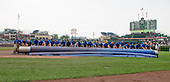 The tarp is removed from the infield at  Wrigley Field in Chicago, Illinois during the rain delay prior to the game against the Washington Nationals on Thursday, August 22, 2013.<br /> Credit: Ron Sachs / CNP