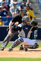 New York Yankees catcher Francisco Arcia #87 and umpire Kolin Kline during a Spring Training game against the Pittsburgh Pirates at Legends Field on March 28, 2013 in Tampa, Florida.  (Mike Janes/Four Seam Images)