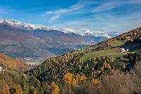 Italy, South-Tyrol (Alto Adige - Trentino), Vinschgau (Val Venosta), view from village Stelvio at village Prato Allo Stelvio and some mountain farms, at background snowcapped summits of Oetztal Alps   Italien, Suedtirol, Vinschgau, Blick von Stilfs auf Prad am Stilfserjoch und den Prader Berg mit einigen Bergbauernhoefen, dahinter die schneebedeckten Gipfel der Oetztaler Alpen
