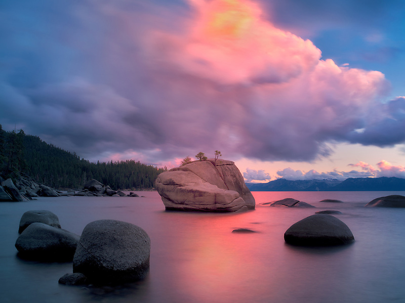 Sunset clouds and granite boulders on east side of Lake Tahoe, Nevada