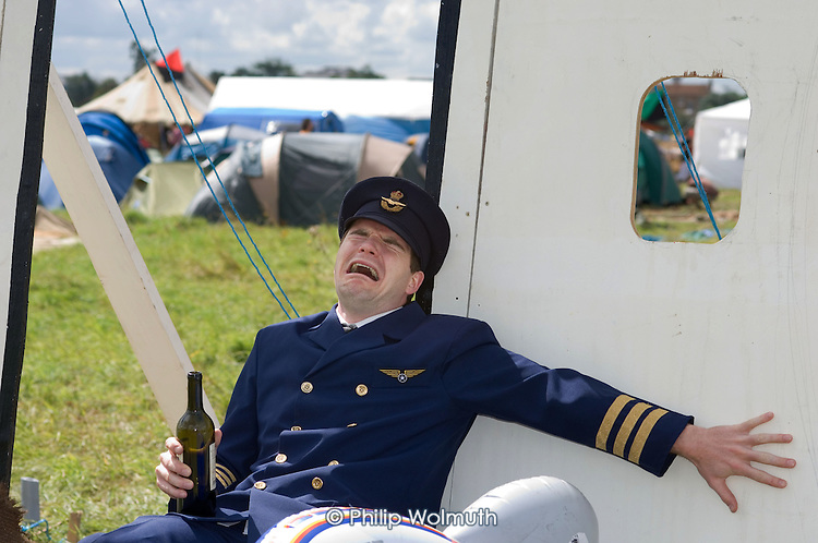 Protestor dressed as a pilot at the Camp for Climate Action at Heathrow, West London, the world's busiest airport.