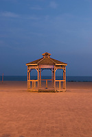 AVAILABLE FROM JEFF AS A FINE ART PRINT<br /> <br /> AVAILABLE FROM PLAINPICTURE FOR COMMERCIAL AND EDITORIAL LICENSING.  Please go to www.plainpicture.com and search for image # p5690044.<br /> <br /> Coney Island - Gazebo on the Beach at Dusk, Brooklyn, New York City, New York State, USA