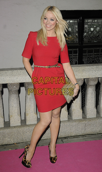 LIZ McCLARNON.The Inspiration Awards for Women, Cadogan Hall, Sloane Terrace, London, England..October 6th, 2010.full length red dress leopard print shoes brown beige clutch bag belt gold studs studded hand in pocket .CAP/CAN.©Can Nguyen/Capital Pictures.