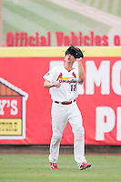 Stephen Piscotty (12) of the Springfield Cardinals catches a ball in right field during a game against the Northwest Arkansas Naturals at Hammons Field on July 28, 2013 in Springfield, Missouri. (David Welker/Four Seam Images)