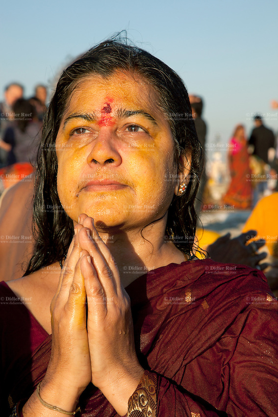 India. Uttar Pradesh state. Allahabad. Maha Kumbh Mela. A woman prays after a holy dip in Sangam. In the Hinduism, the tilaka, tika or tilakam or tilak is a mark created by the smearing of powder or paste and worn on the forehead. Tilaka may be worn on a daily basis or for special religious occasions. The Kumbh Mela, believed to be the largest religious gathering is held every 12 years on the banks of the 'Sangam'- the confluence of the holy rivers Ganga, Yamuna and the mythical Saraswati. The Maha (great) Kumbh Mela, which comes after 12 Purna Kumbh Mela, or 144 years, is always held at Allahabad. Uttar Pradesh (abbreviated U.P.) is a state located in northern India. 7.02.13 © 2013 Didier Ruef
