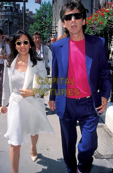 GEORGE HARRISON & WIFE OLIVIA.www.capitalpictures.com.sales@capitalpictures.com.© Capital Pictures.dead, deceased, ex-beatles, paparazzi, walking