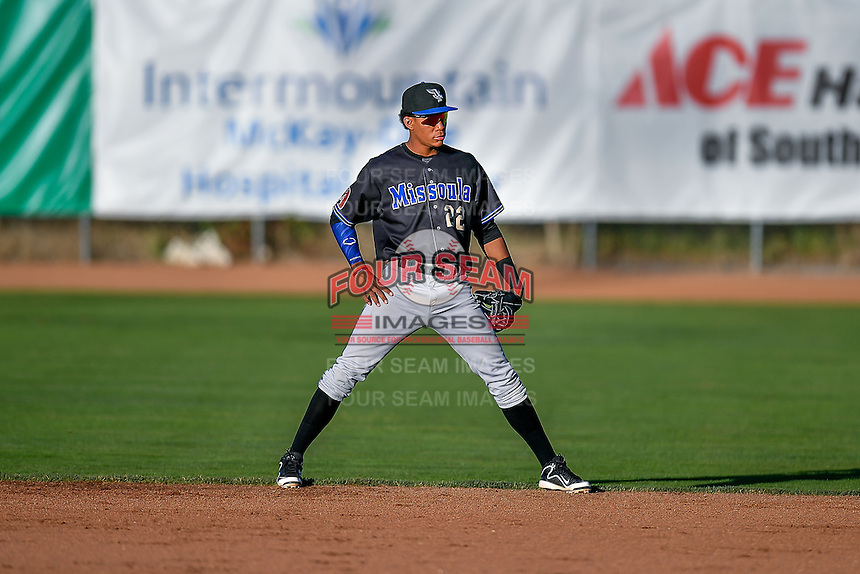 Yan Sanchez (22) of the Missoula Osprey on defense against the Ogden Raptors in Pioneer League action at Lindquist Field on July 13, 2016 in Ogden, Utah. Ogden defeated Missoula 8-2. (Stephen Smith/Four Seam Images)