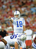 Sept. 27, 2009; Glendale, AZ, USA; Indianapolis Colts quarterback (18) Peyton Manning calls a play against the Arizona Cardinals at University of Phoenix Stadium. Indianapolis defeated Arizona 31-10. Mandatory Credit: Mark J. Rebilas-
