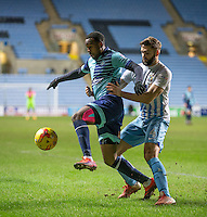 Myles Weston of Wycombe Wanderers holds off Jordan Turnbull of Coventry City Coventry supporters invade the pitch to celebrate there 2-1 during the The Checkatrade Trophy - EFL Trophy Semi Final match between Coventry City and Wycombe Wanderers at the Ricoh Arena, Coventry, England on 7 February 2017. Photo by Andy Rowland.