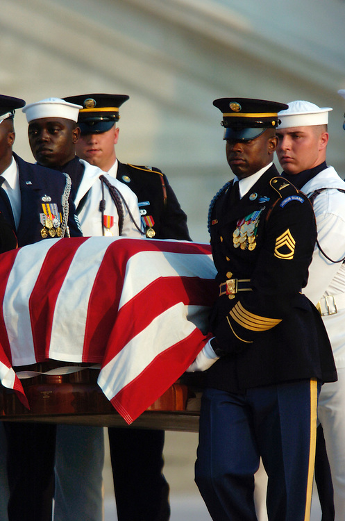 The 3rd Infantry Division Old Guard transfers former President Ronald Reagan's casket from the horse-drawn caisson to take him to  to lie in state in the Rotunda of the U.S. Capitol.