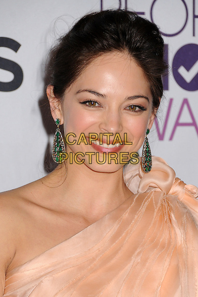 Jay Ryan & Kristin Kreuk .People's Choice Awards 2013 - Press Room held at Nokia Theatre L.A. Live, Los Angeles, California, USA..January 9th, 2013.headshot portrait dangling earrings green smiling peach one shoulder top gold .CAP/ADM/BP.©Byron Purvis/AdMedia/Capital Pictures.