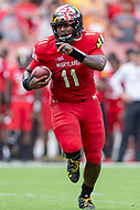 Landover, MD - September 1, 2018: Maryland Terrapins quarterback Kasim Hill (11) points out who to block as he runs the football during game between Maryland and No. 23 ranked Texas at FedEx Field in Landover, MD. The Terrapins upset the Longhorns in back to back season openers with a 34-29 win. (Photo by Phillip Peters/Media Images International)