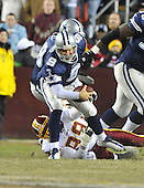 Landover, MD - December 27, 2009 -- Dallas Cowboys quarterback Tony Romo (9) avoide being tackled by Washington Redskins defensive end Andre Carter (99) in second quarter action at FedEx Field in Landover, Maryland on Sunday, December 27, 2009..Credit: Ron Sachs / CNP.(RESTRICTION: NO New York or New Jersey Newspapers or newspapers within a 75 mile radius of New York City)
