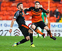 Dundee Utd's Paul Paton is taken out late by Killie's Lee Miller.