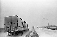 Interstate 80 (I-80) in winter. The interstate is a direct route from the East Coast to the West coast and visa versa. Semi trucks and snow rule these roads during the winter months. Nebraska, USA, February 2004 © Stephen Blake Farrington