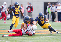 Saturday, November 2nd, 2013: California's John Sheperdson and Michael Barton tries to recover Arizona's fumble during a game at Memorial Stadium, Berkeley, Final Score: Arizona defeated California 33-28