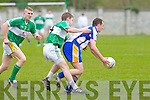 Keel's Gary Nagle get to the ball before Na Gaeil's Ian McCarthy in the Junior Club Championship in Tralee on Sunday.