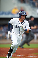 Charlotte Stone Crabs left fielder David Olmedo-Barrera (15) runs to first base during the first game of a doubleheader against the Tampa Yankees on July 18, 2017 at Charlotte Sports Park in Port Charlotte, Florida.  Charlotte defeated Tampa 7-0 in a game that was originally started on June 29th but called to inclement weather.  (Mike Janes/Four Seam Images)