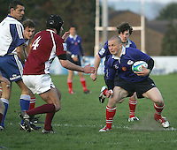 Russia scrum half Alexey Tolstykh strains every muscle to side-step the expected tack from Georgia second row David Chichua in the match at Malone Belfast in the 2007 Under 19 RWC.