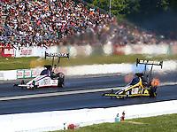 Jun. 1, 2014; Englishtown, NJ, USA; NHRA top fuel driver Tony Schumacher (right) races alongside Antron Brown during the Summernationals at Raceway Park. Mandatory Credit: Mark J. Rebilas-