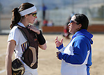 Western Nevada College's head softball coach Leah Wentworth talks to catcher Alia Cox during a college softball game against Colorado Northwestern on Friday, Feb. 22, 2013, in Carson City, Nev..Photo by Cathleen Allison