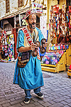 A gnawa musician performes in the medina of Fés, Morocco.