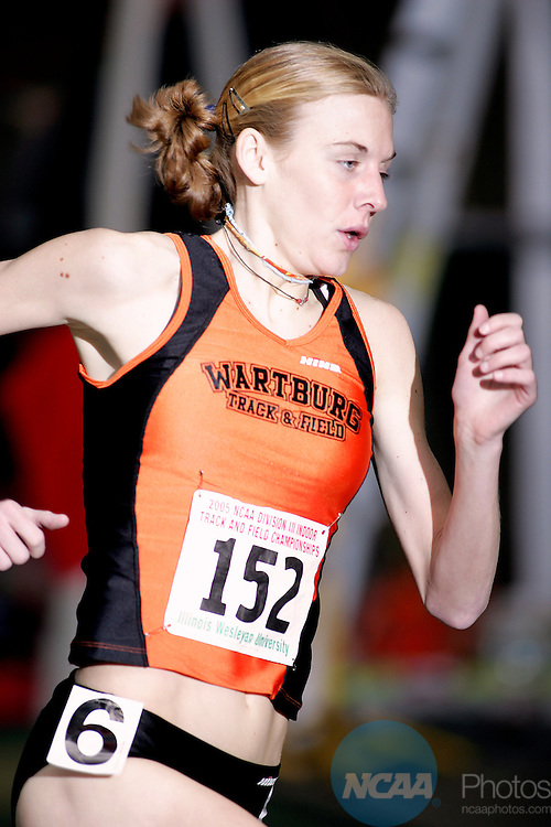 12 March 2005: Missy Buttry of Wartburg College makes her way around the track in the mile run during the Division 3 Indoor Track and Field Championships held at Shirk Center in Bloomington, Illinois.  Buttry took home the mile run title, finishing with a time of 4:43.92.  Clark Brooks/NCAA Photos.