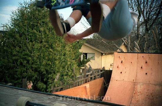 Joey Vela skating Ted's ramp. Selena watching.; San Ramon, CA<br />