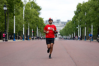 16th May 2020, London, England;  Runner wearing Crisis charity t shirt while running towards Buckingham Palace on the mall while not wearing gloves or a mask
