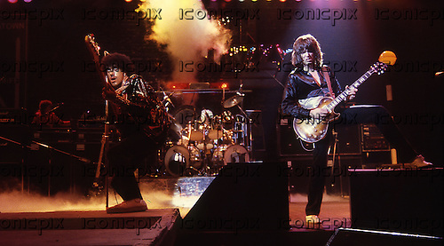 Thin Lizzy - Phil Lynott and gutiarist Scott Gorham performing live at the Odeon Hammersmith London UK - 28 May 1980.  Photo credit: George Chin/IconicPix