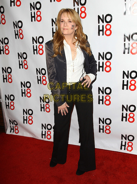 Lea Thompson.NOH8's 3 year Anniversary Celebration.Held At The House of Bluesl, West Hollywood, California, USA..December 13th, 2011.full length jacket suspenders braces trousers hand on hip white shirt black jacket writing painting on face cheek.CAP/ADM/KB.©Kevan Brooks/AdMedia/Capital Pictures.
