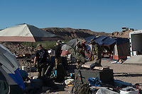 Militia members manage ammunition and other supplies in camp &quot;Liberty&quot; near the Cliven Bundy ranch in Bunkerville, Nevada, USA.<br />