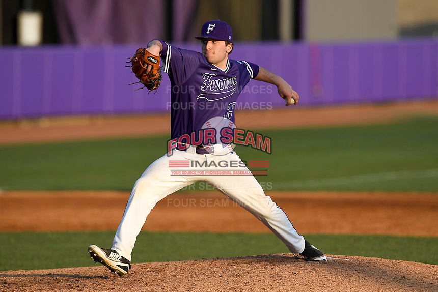 Starting pitcher Matt Lazzaro (25) of the Furman Paladins delivers a pitch in game two of a doubleheader against the Harvard Crimson on Friday, March 16, 2018, at Latham Baseball Stadium on the Furman University campus in Greenville, South Carolina. Furman won, 7-6. (Tom Priddy/Four Seam Images)