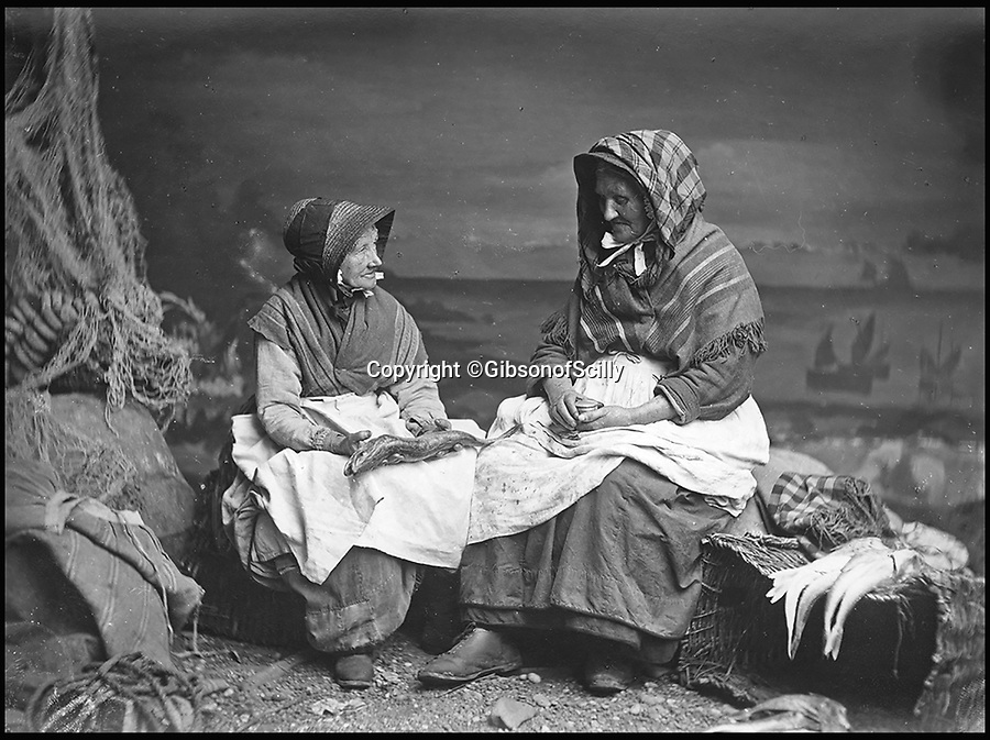 BNPS.co.uk (01202 558833)<br /> Pic: GibsonOfScilly/BNPS<br /> <br /> Cornish fishwife's in 1890.<br /> <br /> An archive of eye-opening photographs documenting the grim reality of Poldark's Cornwall has emerged for sale for &pound;25,000.<br /> <br /> More than 1,500 black and white images show the gritty lives lived by poverty-stricken families in late 19th and early 20th century Cornwall - around the same time that Winston Graham's famous Poldark novels were set.<br /> <br /> The collection reveals the lowly beginnings of towns like Rock, Fowey, Newquay and St Ives long before they became picture-postcard tourist hotspots.<br /> <br /> Images show young filth-covered children playing barefoot in squalid streets, impoverished families standing around outside the local tax office, and weather-beaten fishwives tending to the day's catch.<br /> <br /> The Cornish archive, comprising 1,200 original photographic prints and 300 glass negative plates, is tipped to fetch &pound;25,000 when it goes under the hammer as one lot at Penzance Auction House.