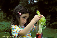 PM03-008z  Plant experiment - girl putting celery in food colored water, travel of water through stem (seq. PM03-008z,PM04-008z,009z)