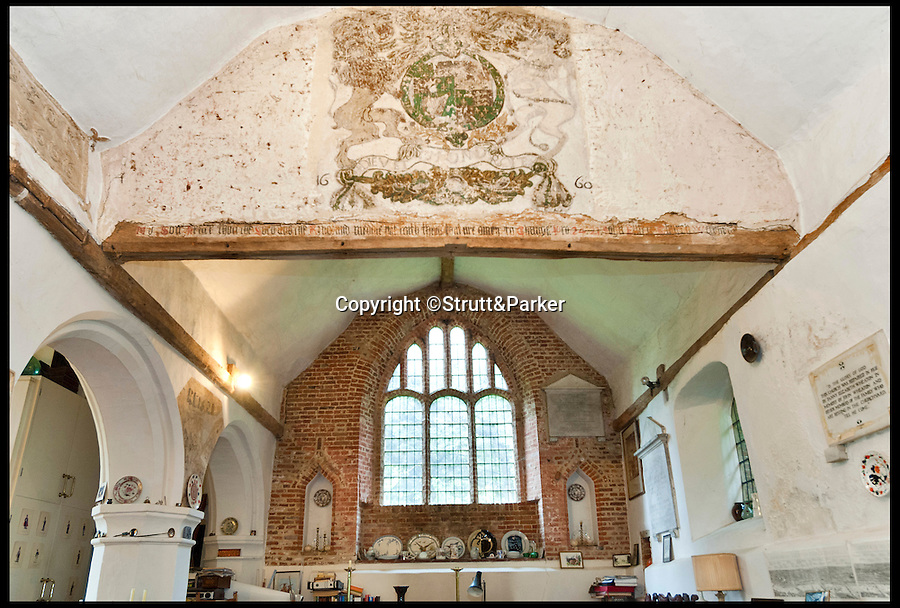 BNPS.co.uk (01202 558833)<br /> Pic: Strutt&Parker/BNPS<br /> <br /> *Please use full byline*<br /> <br /> An interior shot of the building's rustic walls.<br /> <br /> The owner of this converted church will be praying that a still in use graveyard won't put people off snapping up his unusual home.<br /> <br /> Old All Saints Church dates from the early 16th century with additions and renovations added later, but the churchyard around it is open to the public and still has one or two burials a year.<br /> <br /> The quirky home, which is Grade II* listed and almost 1,300 sq ft, consists of a kitchen and bathroom in the chapel, the nave and chancel have been converted to create a living, dining and study areas and a mezzanine floor was put in to create a bedroom.<br /> <br /> The current owner bought it as a derelict church in the 1970s and got planning permission to turn it into a home. He has lived there since but, following the death of his partner, decided to downsize and sell this unusual property.<br /> <br /> Sharnie Rogers from Strutt & Parker, who are selling the property, said it still has all the characteristics of a church and there is still potential for more conversion to be done.
