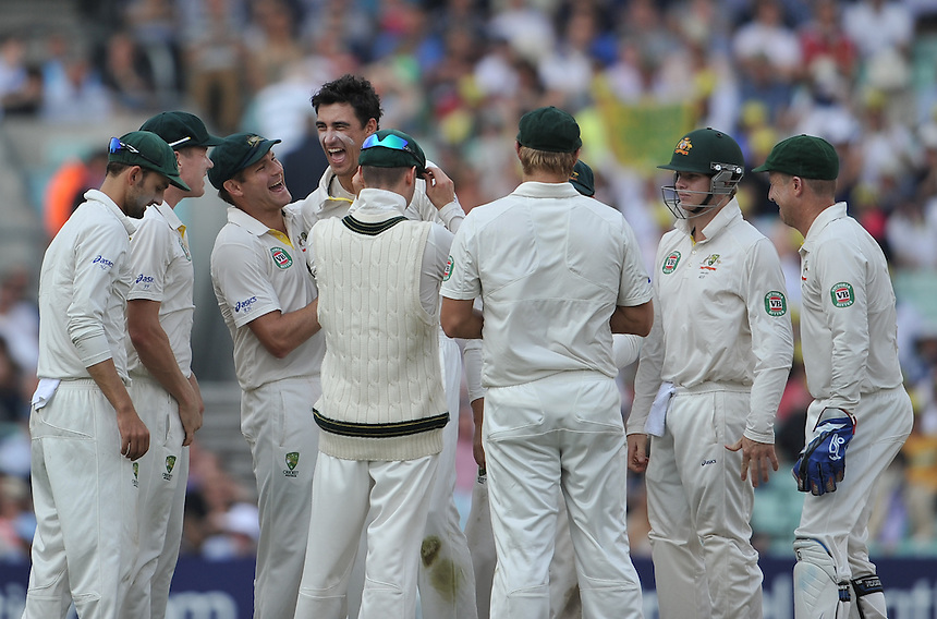 Mitchell Starc congratulated by his team mates after taking the wicket of Stuart Broad <br /> <br /> SCJ Broad b Starc 9<br /> <br />  Photo by Ashley Western/CameraSport <br /> <br /> International Cricket - Fifth Investec Ashes Test Match - England v Australia - Day 5 - Sunday 25th August 2013 - The Kia Oval - London<br /> <br /> &copy; CameraSport - 43 Linden Ave. Countesthorpe. Leicester. England. LE8 5PG - Tel: +44 (0) 116 277 4147 - admin@camerasport.com - www.camerasport.com