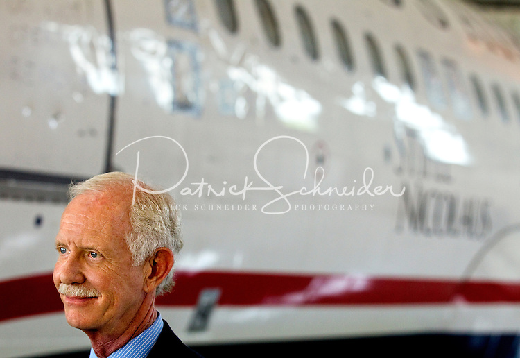 """Captain Chesley """"Sully"""" Sullenberger was in Charlotte NC to greet the arrival of US Airways Flight 1549, also known as the Miracle on the Hudson plane, at the Carolina Aviation Museum in Charlotte, NC.  Two years earlier, the commercial passenger flight was enroute to Charlotte/Douglas International Airport when it was successfully landed in New York's Hudson River after striking a flock of Canada Geese six minutes after taking off from LaGuardia Airport."""