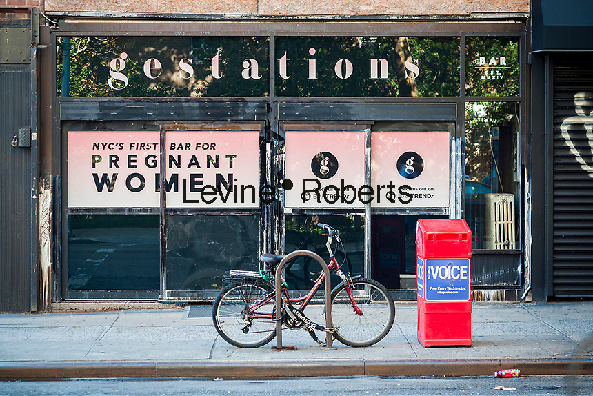 "A sign on a storefront on Saturday, September 27, 2014 in the East Village in New York heralds the imminent arrival of Gestations, NYC's first bar for pregnant women. The sign appears to be a guerrilla marketing gimmick for the app ""BARTRENDr"" as there has been no liquor license application submitted. The bar promotes drinking for two, the bigger the belly the more you can drink, and free pregnancy kits with a pitcher of beer. (© Richard B. Levine)"