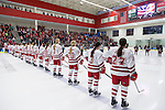 Wisconsin Badgers line up during the National Anthem prior to the first round game of the NCAA tournament against the Harvard Crimson Saturday, March 15, 2014 in Madison, Wis. The Badgers won 2-1 and advance to the Frozen Four. (Photo by David Stluka)