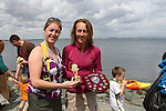 """Sue McKinney presents Trudy Brown with her Ladies 1st place at the Clogherhead """"Round the Head Swim""""....(Photo credit should read Jenny Matthews/NEWSFILE)..."""